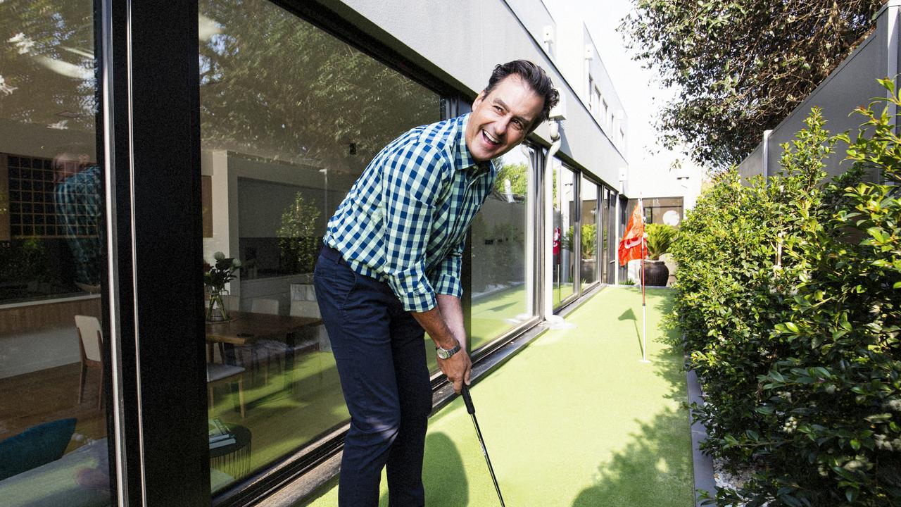 Golfing great Mark Allen testing out the putting green. Picture: Peter Nevett