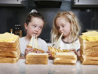 Story on revealing the new name of Coon cheese. Five year-olds, Charlotte and Matisse who love a good cheese toastie, no matter what itÕs called.                Picture: David Caird