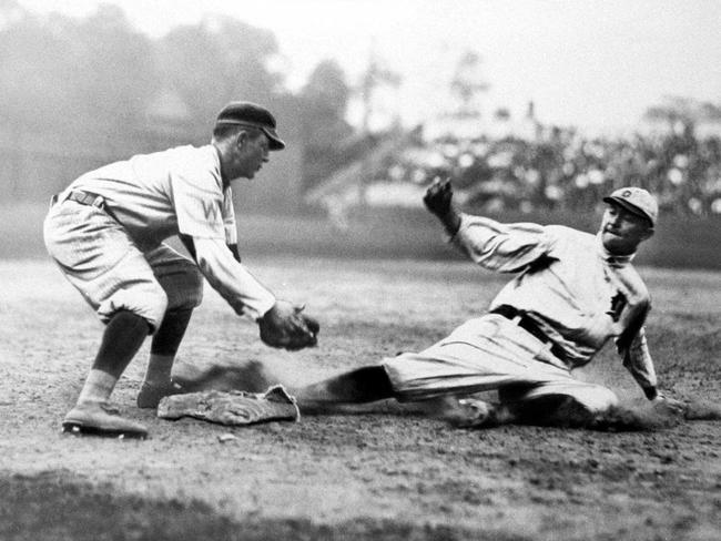 Ty Cobb (right) sliding into a base.
