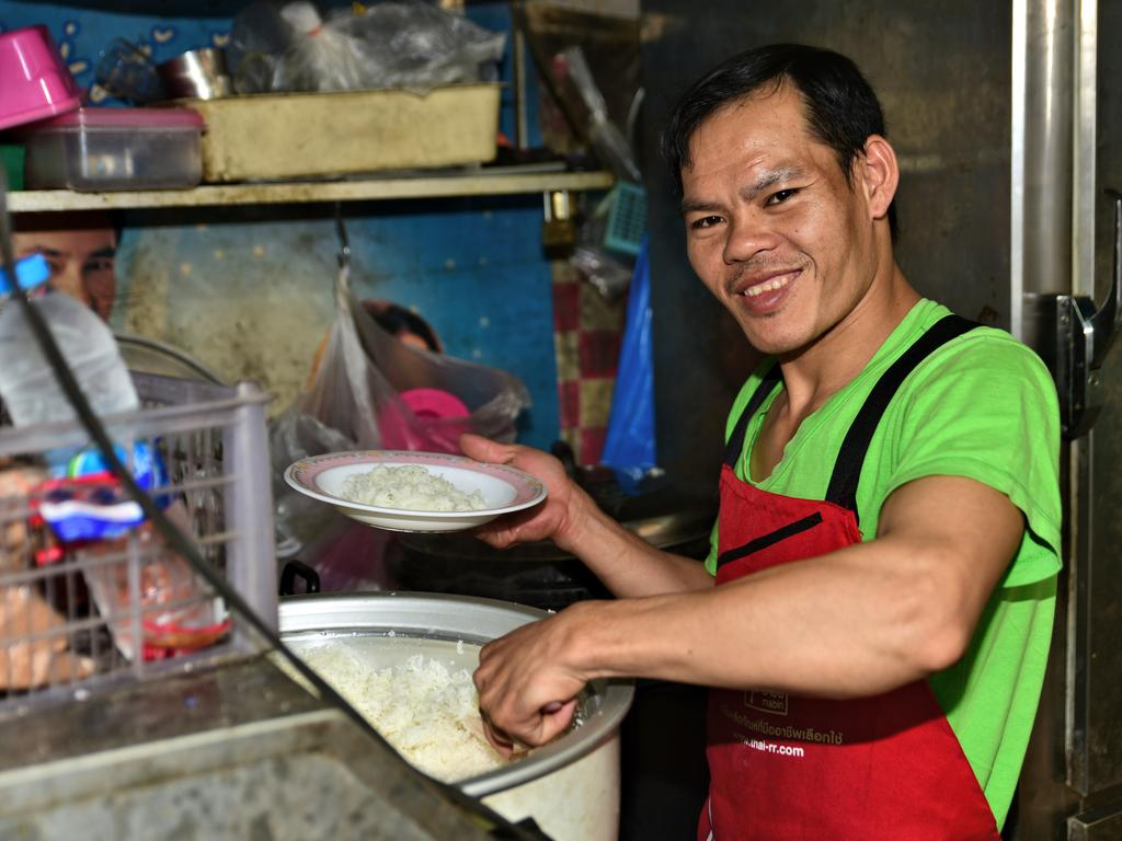 A man cooks up the goods at Yaowarat, one of the foodie havens that survived the cull. Picture: Ronan O'Connell