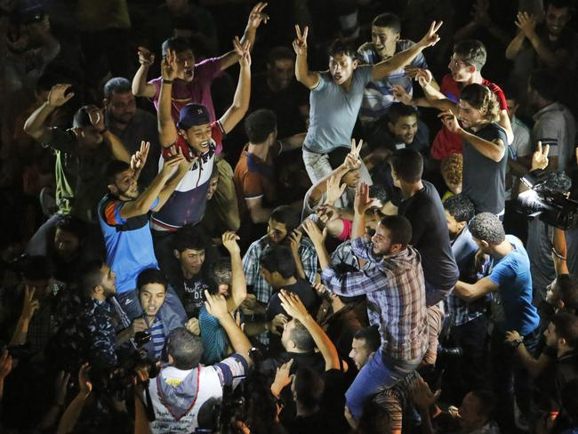 Jubilant scenes ... Palestinians take to the streets in celebration at the news Hamas has kidnapped an Israeli soldier.