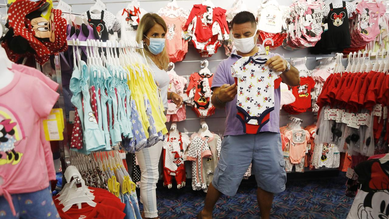 Nikki Hastings and Carlos Aguilera gift shop for Disney apparel for relatives at the LBV Gift Shop on July 8, 2020 in Lake Buena Vista, Florida. Picture: Octavio Jones/Getty Images/AFP