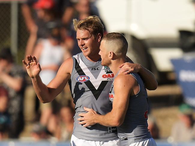 Jack Watts and Robbie Gray celebrate.