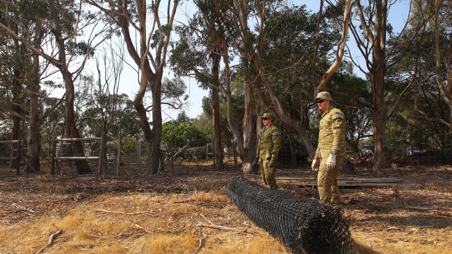 Army Reserves help clear land and build koala enclosures at the Kangaroo Island Wildlife Park in Parndana. Picture: Lisa Maree Williams/Getty