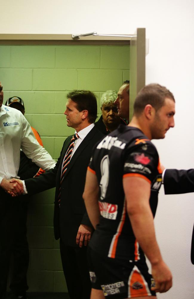 Mick Potter and Robbie Farah enter a press conference. Pic: Brett Costello