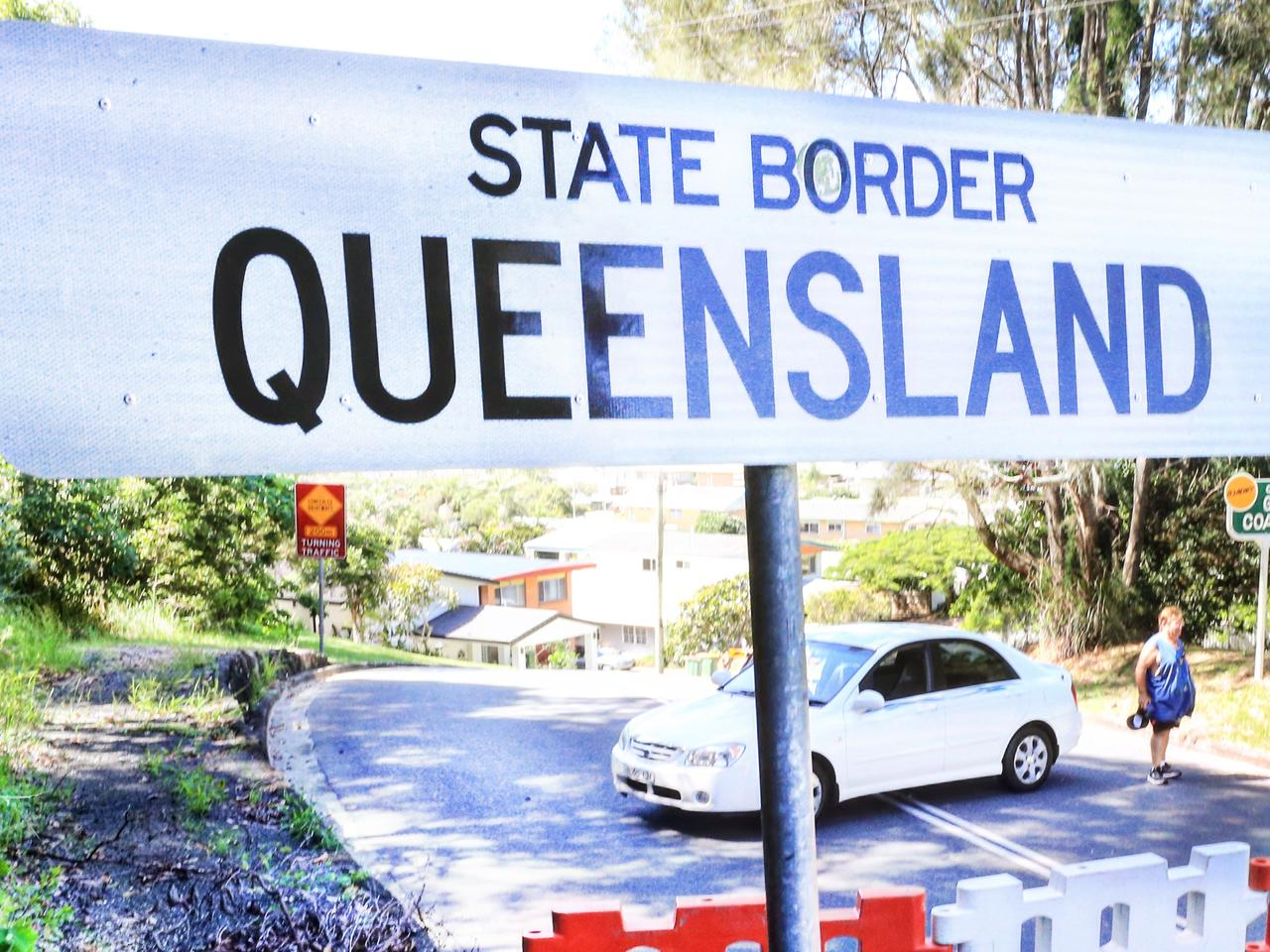 A stranded driver tries to re enter Tweed Heads NSW at the Queensland Border but due to current Queensland Closed Borders he is unable to drive the 75 metres to his home.Photo: Scott Powick Newscorp
