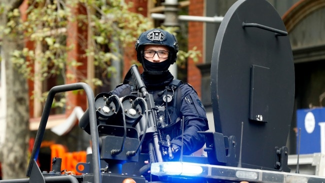 An officer from the Critical Incident Response Team (CIRT) is seen along King Street in Melbourne on Wednesday. Picture: Getty Images