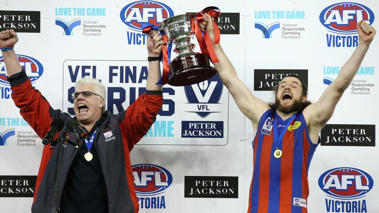Port Melbourne coach Gary Ayres and captain Toby Pinwill raise the last VFL premiership cup . Pic: Michael Klein