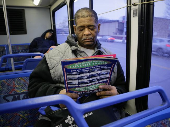 Long commute ... James Robertson would catch a bus for the last few kilometres of his long journey to work. Picture: AP Photo/Detroit Free Press, Ryan Garza