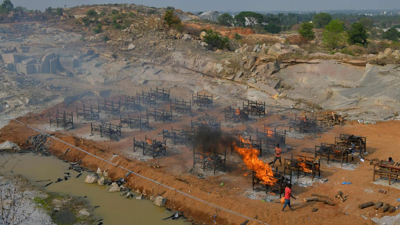 Burning pyres of the victims who died of COVID-19 coronavirus are pictured at an open air crematorium set up inside a defunct granite quarry on the outskirts of Bangalore, India. Picture: Manjunath Kiran / AFP