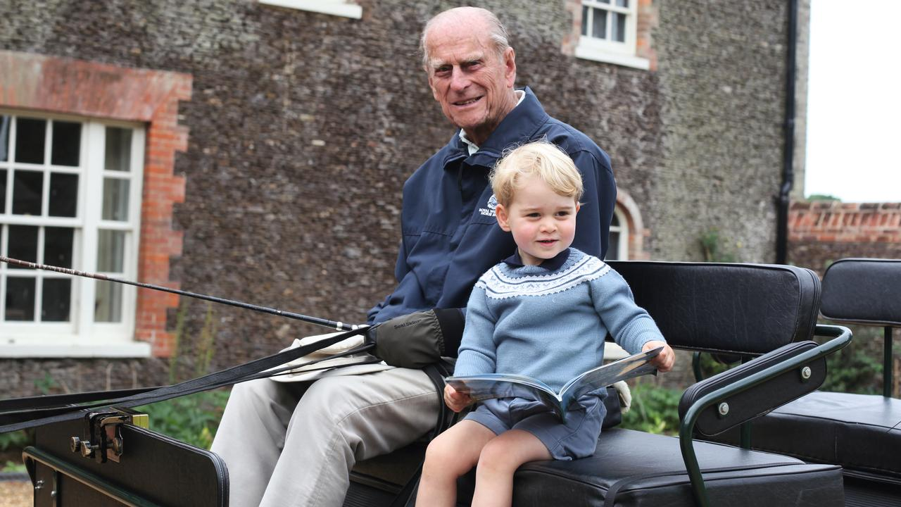 Prince Philip and a young Prince George carriage driving. Picture: The Duchess of Cambridge via Getty Images)