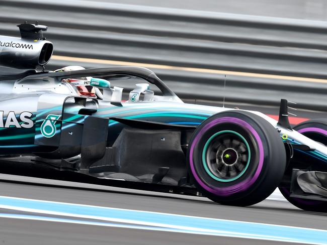 Mercedes' British driver Lewis Hamilton competes to win the pole position