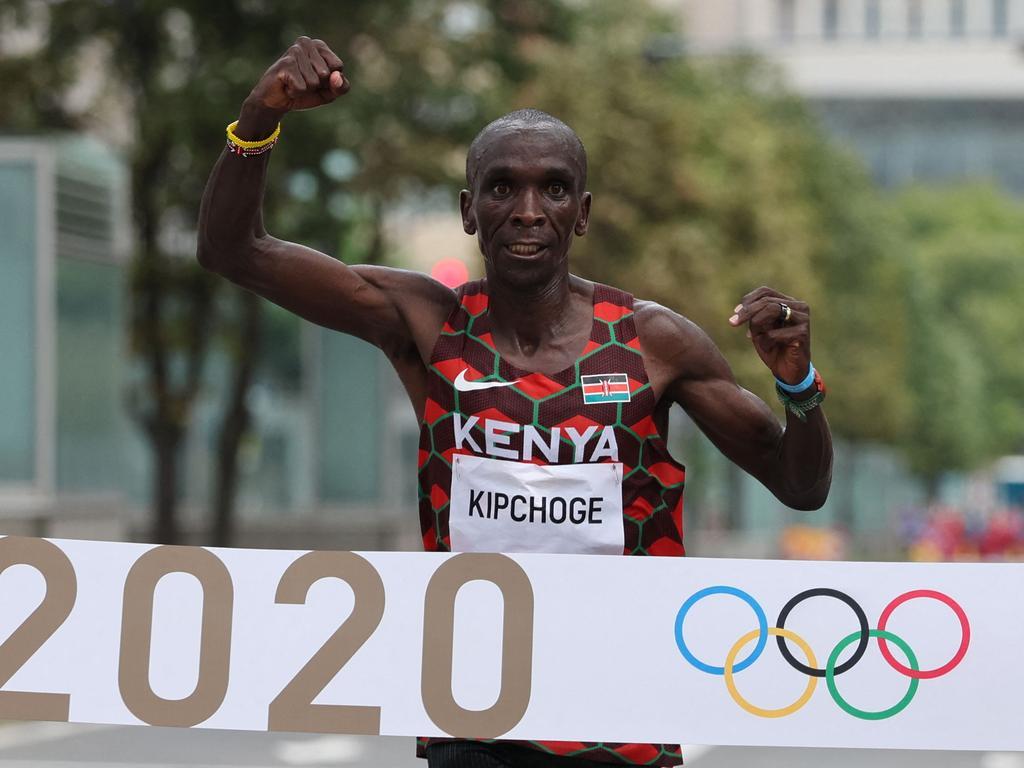 Kenya's Eliud Kipchoge crosses the finish line to win the men's marathon.