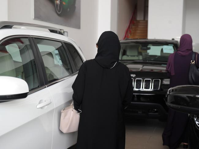 Saudi women stroll at a cars showroom in the Red Sea resort of Jeddah on June 23, 2018, a day before the lifting of a ban on women driving. Picture: AFP