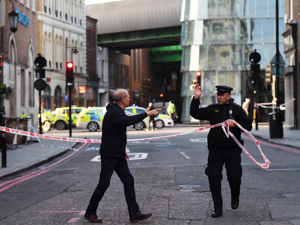 Members of the public are held behind a police cordon near London Bridge: Picture: Chris J Ratcliffe/Getty Images.
