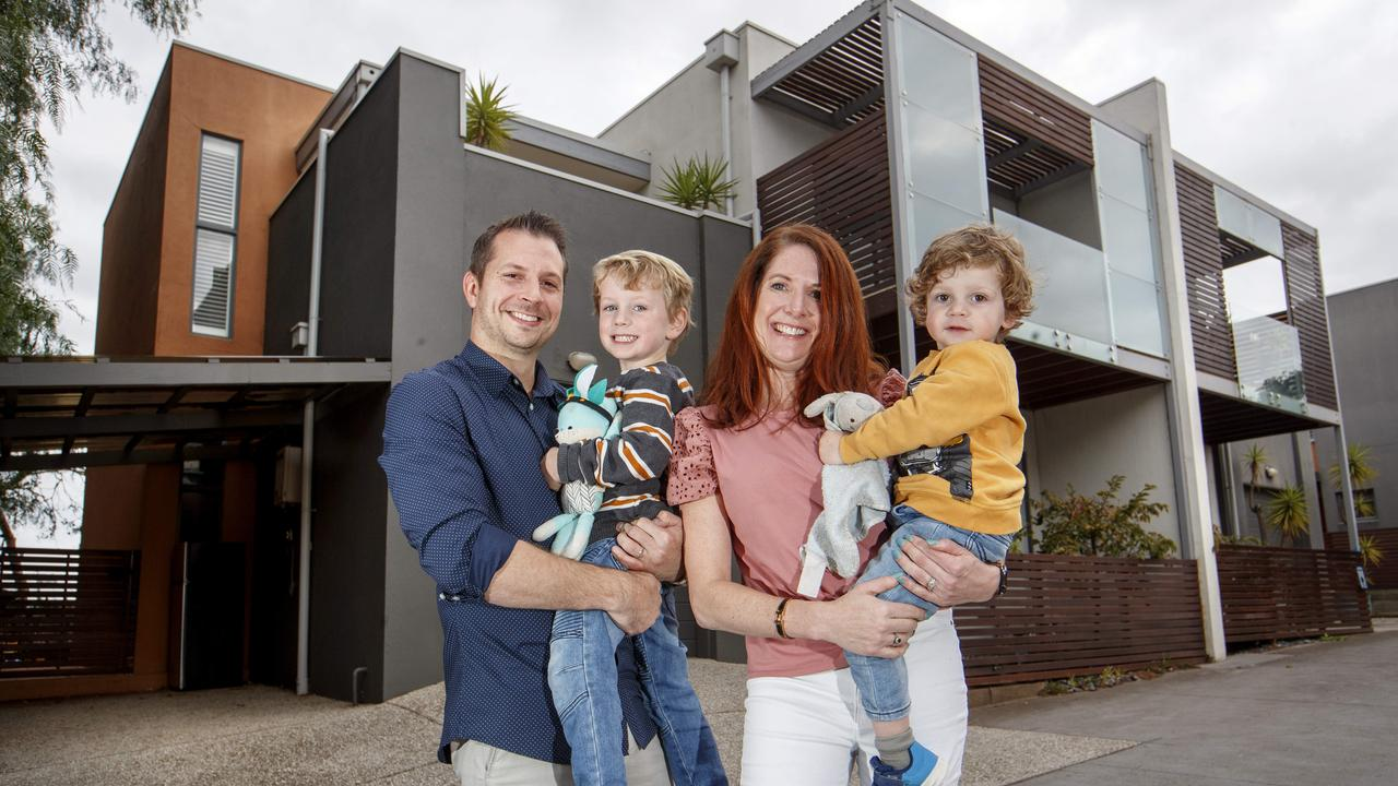 Shaun and Sarah Farrell with children Harvey, 4, and Archer, 2, outside their Yarraville home they consider themselves lucky to have bought. Picture: David Geraghty