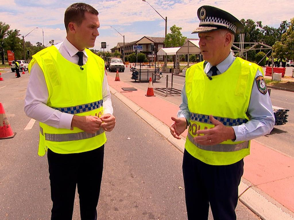 Former Seven News reporter Peter Fegan with NSW Police commissioner Mick Fuller.