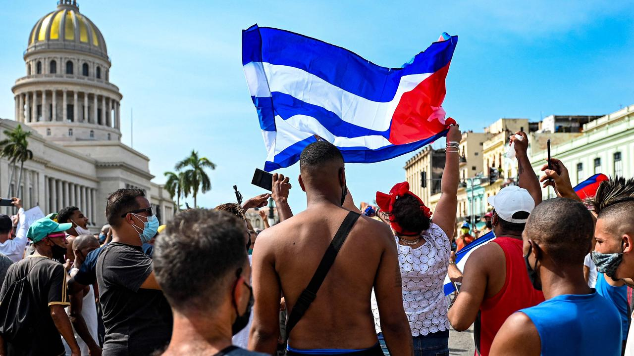 Cuban protesters outside the Capitol in Havana on Sunday. Picture: Yamil Lage/AFP