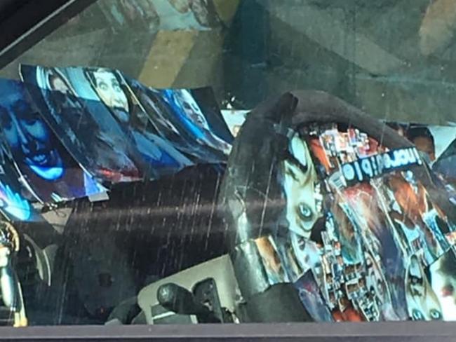 Creepy van plastered with images of teen girls