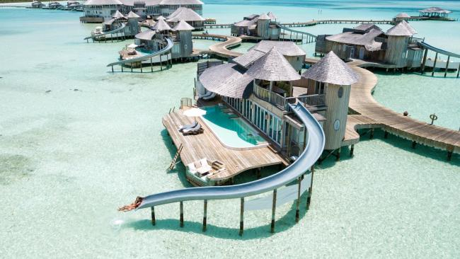 16/20Overwater villa with slide, Soneva Jani, the Maldives What better way to experience the sparkling blue water of the Maldives islands than by sliding straight into it from the top level of a two-storey overwater villa? And for even more water fun, these family suites also have their own swimming pools.