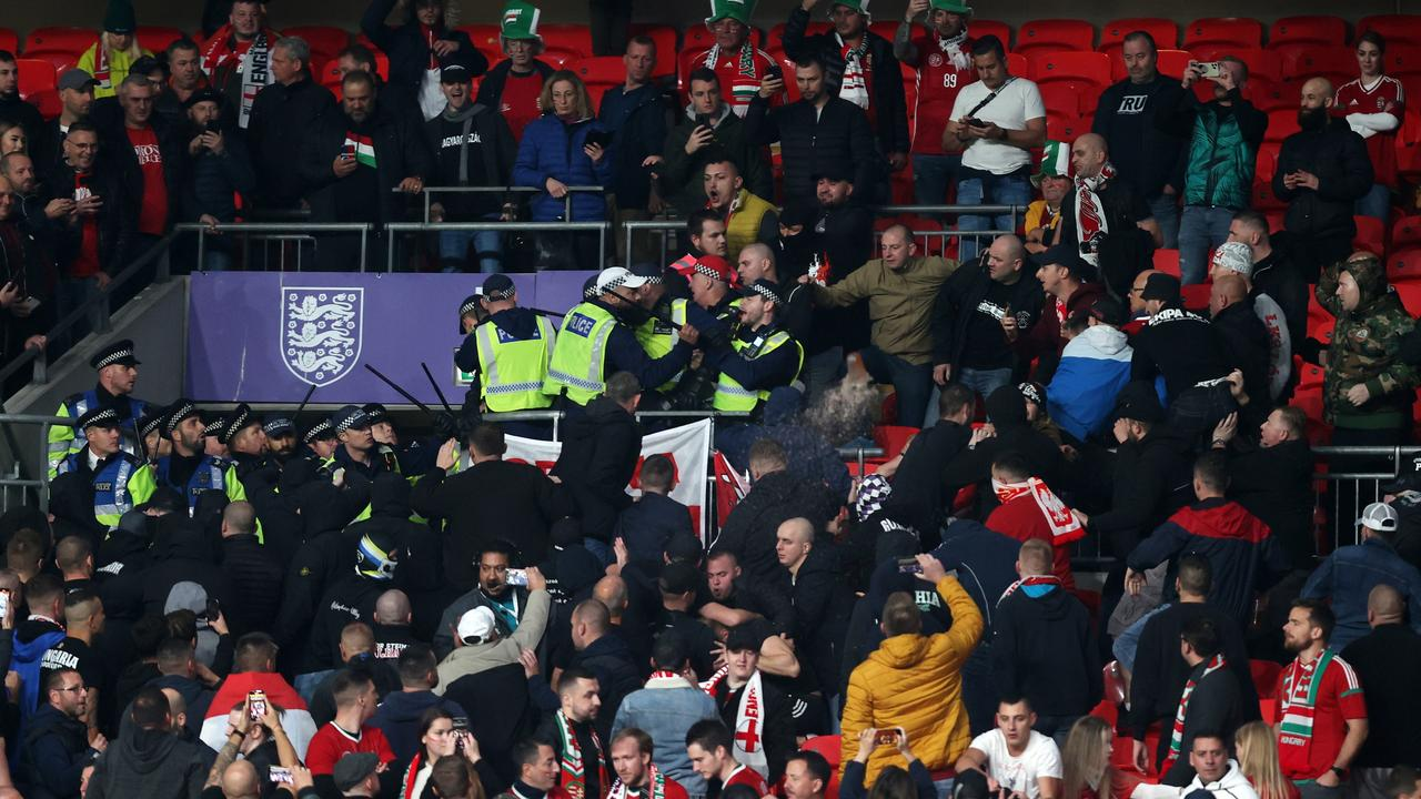 Fans clashed with police in ugly scenes. (Photo by Julian Finney/Getty Images)