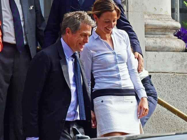 Hugh Grant and his girlfriend Anna Eberstein hot married at a Chelsea registration office. BACKGRID