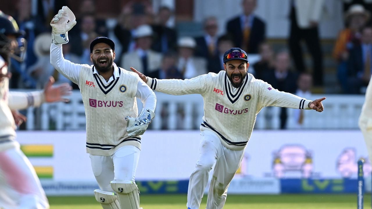 Virat Kohli and Rishabh Pant celebrate a wicket.