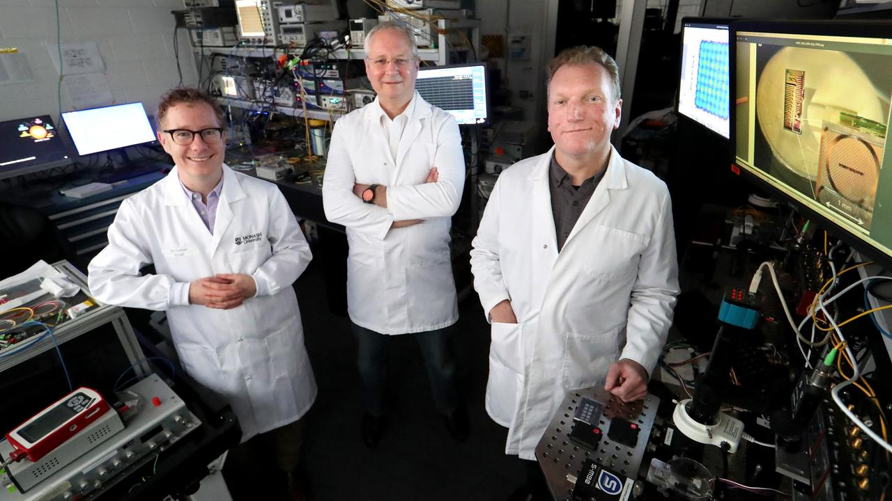 Scientists Bill Corcoran, David Moss and Arnon Mitchell in the lab at RMIT in Victoria where they worked on the experiment that broke the internet speed world record. Picture: David Geraghty