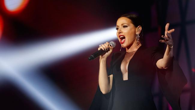 Sizzling ... Tina Arena seizes her moment at the 29th Annual Aria Awards. Picture: Zak Kaczmarek/Getty Images