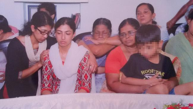Sofia Sam (centre, in red diamond patterned top) at the funeral in India of her husband, for whose alleged murder she is now on trial.