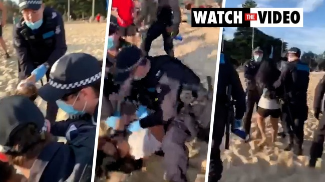 Claims police pushed pregnant woman during beach arrest