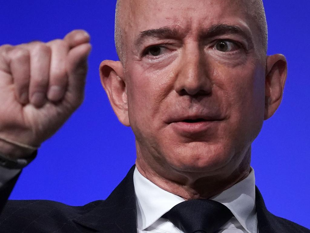 (FILES) In this file photo former Amazon CEO Jeff Bezos, founder of space venture Blue Origin and owner of The Washington Post, participates in an event hosted by the Air Force Association September 19, 2018 in National Harbor, Maryland. - Bill Gates set out to heal the world. His Microsoft co-founder Paul Allen bought sports teams. Ted Turner raced yachts. And Donald Trump went into politics. Amazon founder Jeff Bezos, the world's richest man, plans to build rockets and save the planet.Bezos, 57, is the latest in a line of corporate titans who have stepped away from their day jobs to devote themselves to other activities. Bezos, whose net worth is $197 billion according to Forbes magazine, announced on February 2, 2021 he was resigning as chief executive officer of the online retail giant he launched 27 years ago. (Photo by ALEX WONG / GETTY IMAGES NORTH AMERICA / AFP)