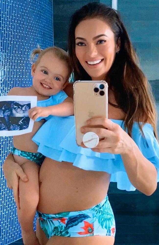 Emily with her daughter Mia, revealed she is pregnant again after trying to conceive for a year. Picture: Instagram/emilyskyefit