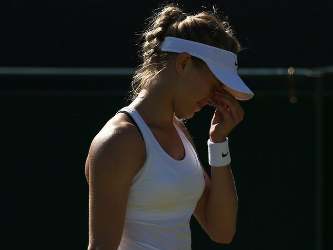 OK, we're not sure if that's a shadow or Eugenie Bouchard's black bra sticking out.