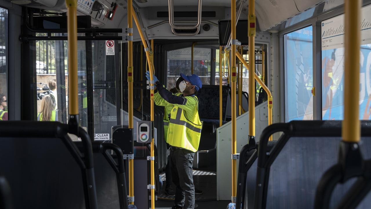 A cleaner at the Waverley Bus Depot on April 29, 2020 in Sydney, NSW wiping surfaces to help stop the spread of the coronavirus. Picture: Getty Images