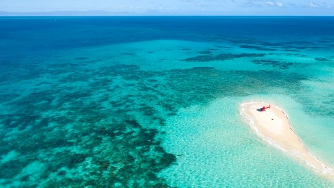 2/26See a world of wonder from above Visible from outer space, World Heritage-listed, and one of the seven natural wonders of the world, Queensland's Great Barrier Reef is the stuff that travel bucket-lists are made of. And you can see the world's largest coral reef system at its best from above by helicopter or seaplane. Picture: Phil Warring