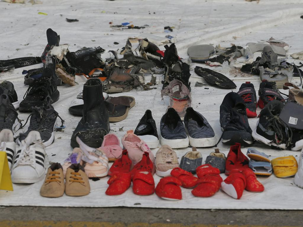 Shoes are among the personal belongings of victims retrieved from the crash site. Picture: AP/Tatan Syuflana