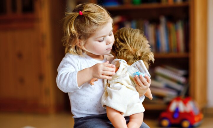 Kids who cradle their dolls on the left are special