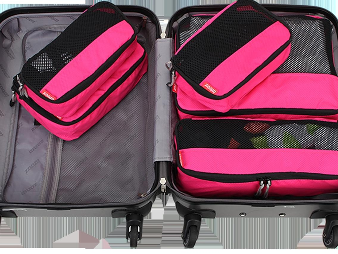 Supplied Travel Escape organised packing story image - Pink Zoomlite packing cells in suitcase, image Zoomlite