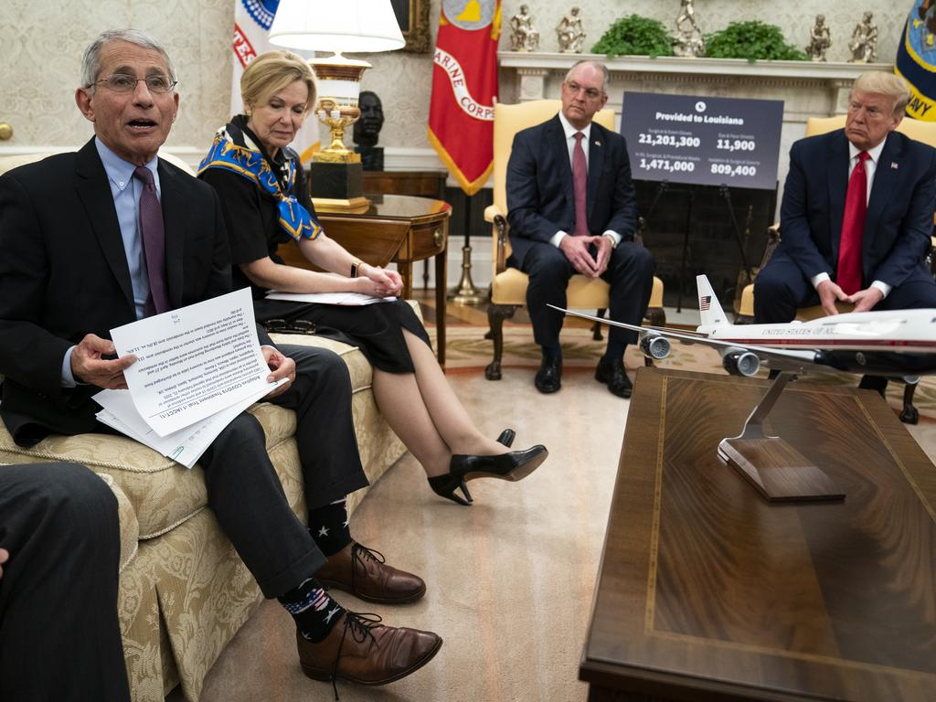 Dr Anthony Fauci (far left) with Donald Trump in the Oval Office. Dr Fauci is currently quarantined after coming into contact with positive White House staffers. Picture: AP