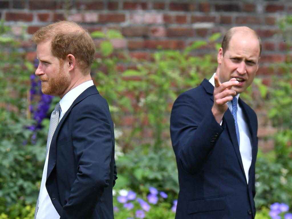 Prince Harry, Duke of Sussex and Prince William, Duke of Cambridge during the unveiling of a statue they commissioned of their mother Diana, Princess of Wales, in the Sunken Garden at Kensington Palace.