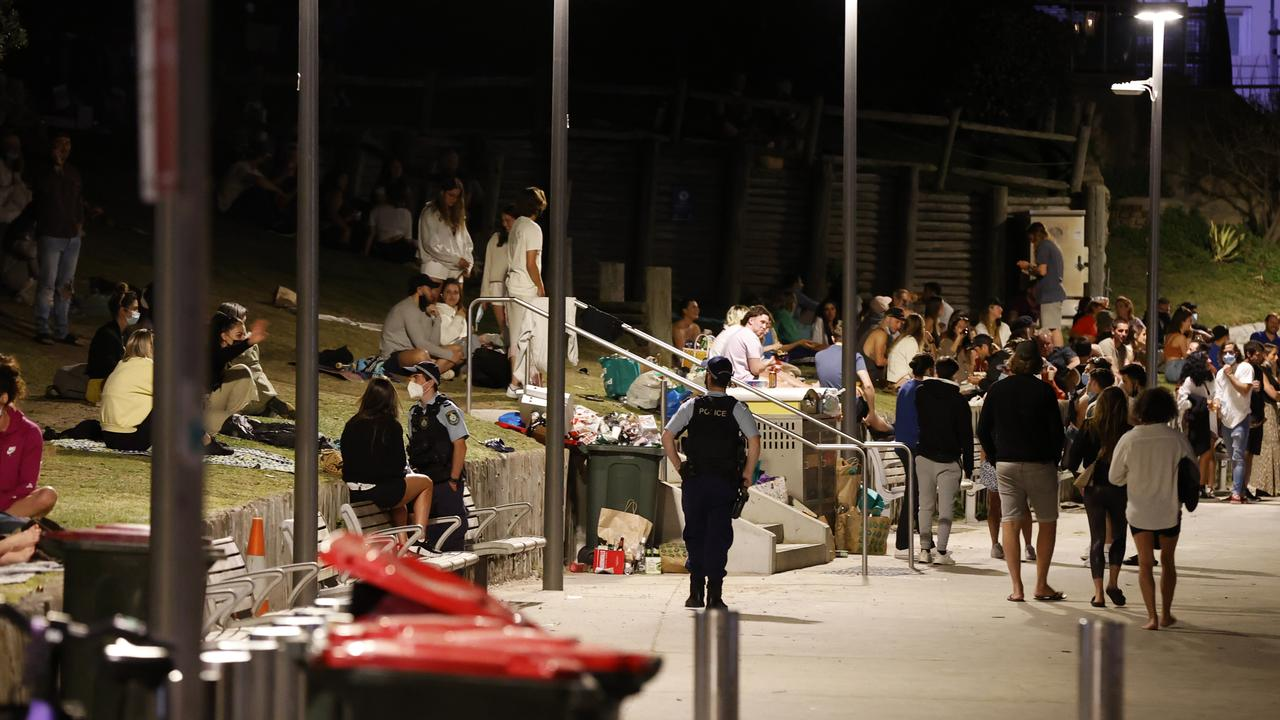 Bondi crowds moved on when told to but it was a different story at Manly. Picture: Jonathan Ng