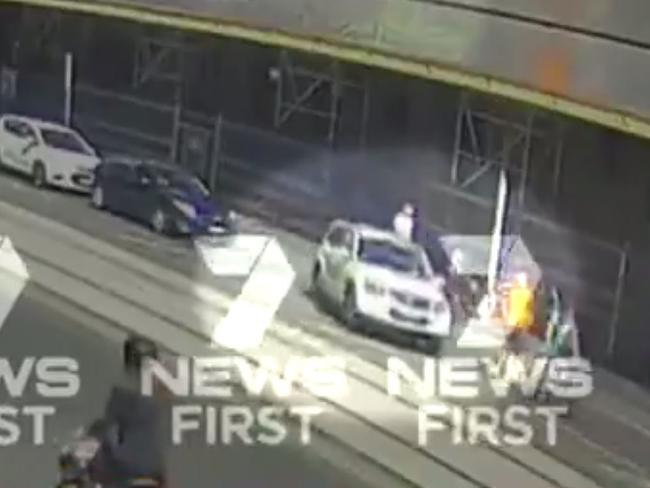 The car was parked in the street before taking off towards crowds of pedestrians. Picture: Channel 7