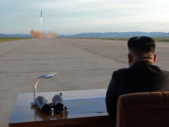 Kim Jong-un inspecting a launching drill of the medium-and-long range strategic ballistic rocket Hwasong-12 at an undisclosed location in September. Picture: AFP