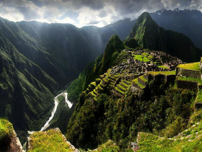 """MACHU PICCHU, PERU: A pilgrimage for most tourists to the continent, this extraordinary """"lost"""" city was rediscovered only early last century. It's not just the ruins themselves, the fascinating stories behind them and the spectacular mountaintop setting that make this site so alluring, but also the process of getting there. Many choose to trek the Inca Trail, a multi-day hike made more challenging by its high altitude. Taking in the stunning scenery while arriving by train is a popular alternative. South America travel specialists Eclipse Travel offer itineraries featuring both options.  eclipsetravel.com.au"""