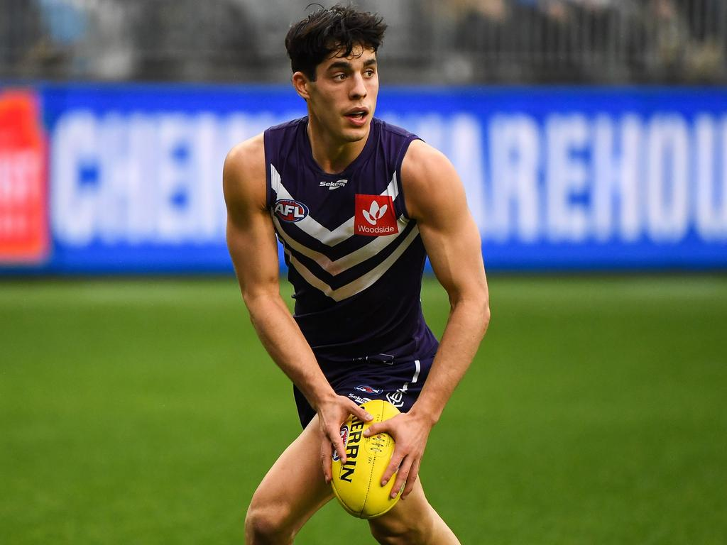 PERTH, AUSTRALIA - AUGUST 08: Adam Cerra of the Dockers looks at his options during the 2021 AFL Round 21 match between the Fremantle Dockers and the Brisbane Lions at Optus Stadium on August 8, 2021 in Perth, Australia. (Photo by Daniel Carson/AFL Photos via Getty Images)