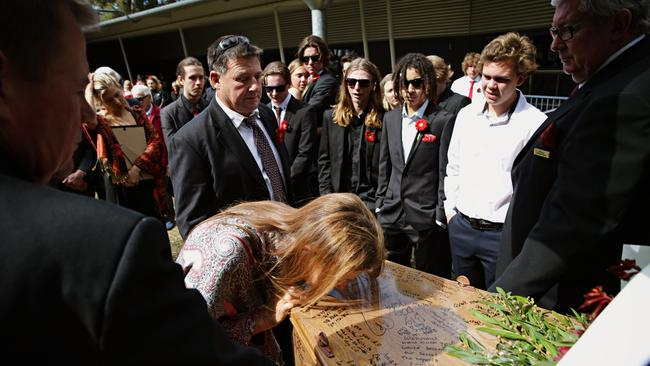 Parents Judi and Geoff Prior farewell their son Angus at Pittwater Uniting Church. Picture: Adam Yip.