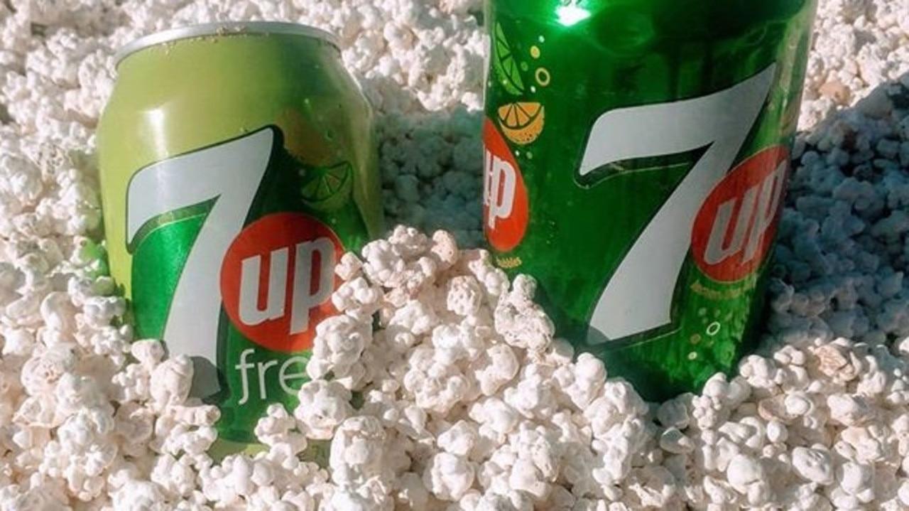 """Cans of soft drink resting in """"popcorn"""" on Popcorn Beach, Canary Islands, Spain. Picture: @_irens_ /Instagram"""