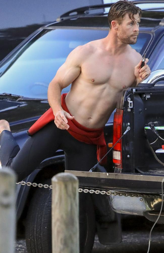 Hemsworth in his natural habitat: topless in a Byron Bay beach carpark. Picture: Media Mode.