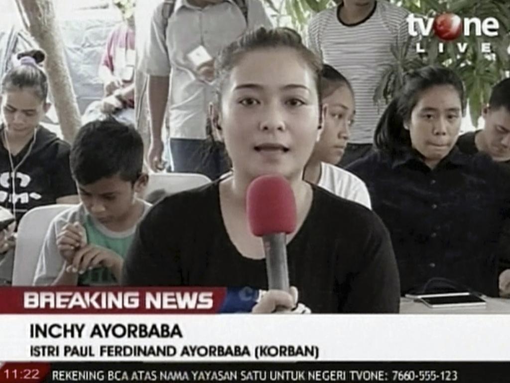 Inchy Ayorbaba, wife of missing passenger Paul Ferdinand Ayorbaba, speaks in a TV interview in Jakarta. Picture: TV One via AP